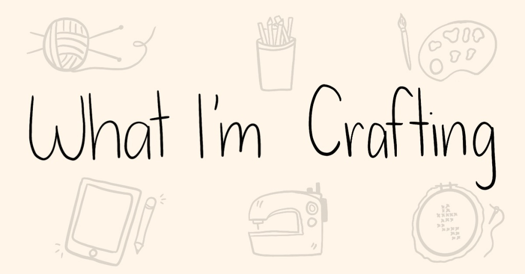 Text 'What I'm Crafting' on a cream background with doodles of knitting yarn, pencils, paint, a drawing tablet, sewing machine, and cross stitch.